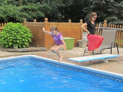 Sofia does a cannon ball jump