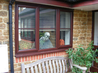 """Deddington:  John positioned """"Dave"""", our favorite Halloween decoration, strategically in the window of our study!"""