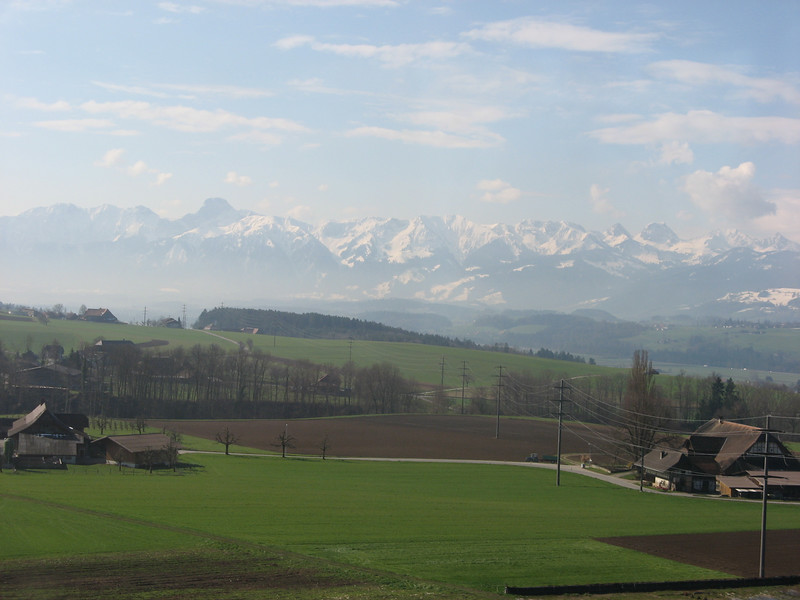 Mountain range in the background taken from the train on the way to Berne.