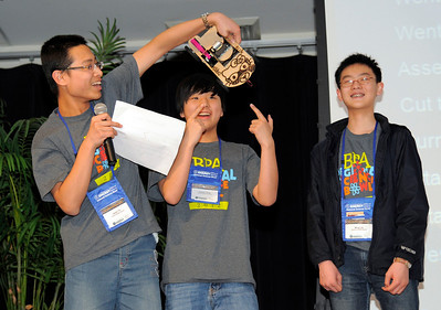 Jason Yu, Austin Jang and ming Liu from Shahala Middle School in Vancouver, Wash., present their Lithium-ion battery powered race car design documents at the 2012 National Science Bowl in Washington, D.C., Saturday, April 28, 2012. Photograph by Jack Dempsey, U.S. Department of Energy, Office of Science   For More Information: National Science Bowl Press Room (301) 961-2854 DOE Public Affairs, (202) 586-4940 Email: National.Science.Bowl@science.doe.gov