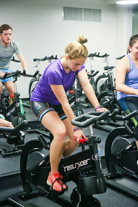 Junior Kinesiology major Amanda Placide adjusts her cycle to increase the difficulty of pedaling