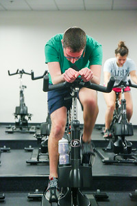 Freshman Accounting major Noah Stumer finishes a sprint on his cycle in tune to the music