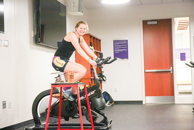 Senior Justice Studies major Jessica Bachelder plays music to keep her club mates motivated during their workout
