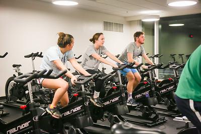 Three freshmen work hard during their cycling workout