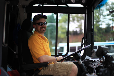 Driver Michael Carper waits happily for more students to get onto his bus