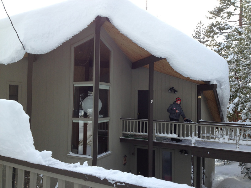 Massive snow bank covers roof. (Sandy photo)
