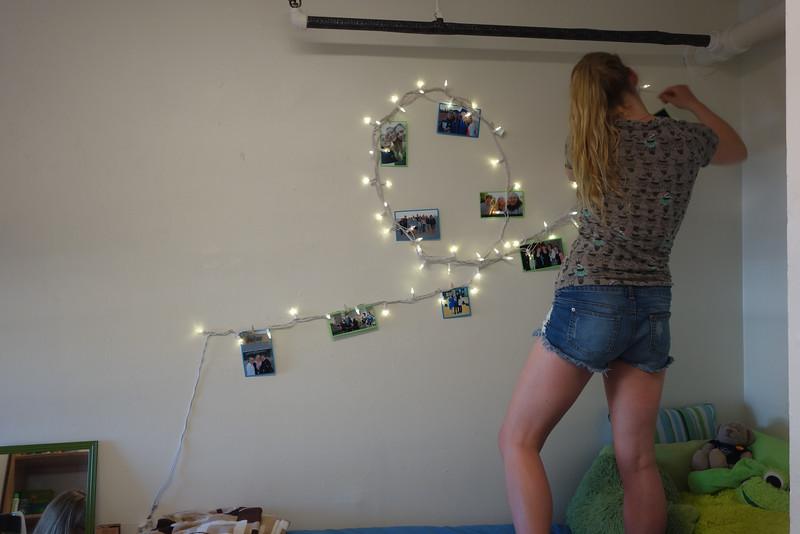 Hanging her lights