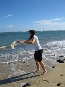 Tauna on her first morning, thowing her lei into the ocean to ensure her return to Hawaii.