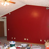 Our accent wall in the main room: posh red anyone?