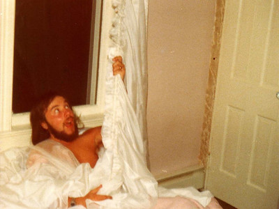 DPB-238: David Prescott Barr, adjusting the curtains, from his bed at 320 West Main Street, Boonton, Summer 1976