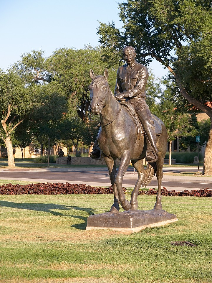 "Statue of Will Rogers. The inscription says ""Riding into the sunset"", but I was told the actual thinking on campus among the students is more like ""riding with his rear pointed towards Austin""..."