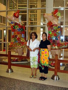 Mom and sister in front of two cows.  Houston Children's Hospital.