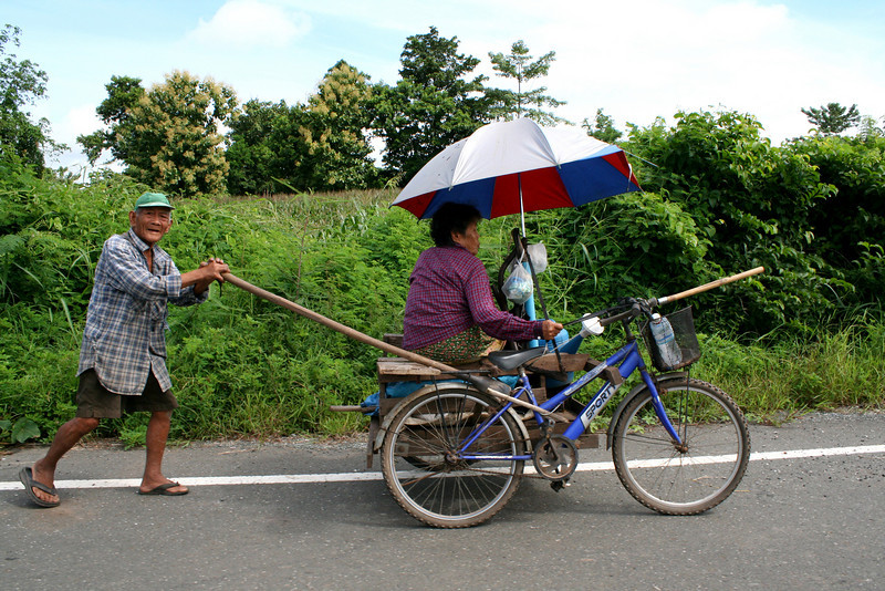 Boosaba's aunt and uncle, on their way to tending their rice field