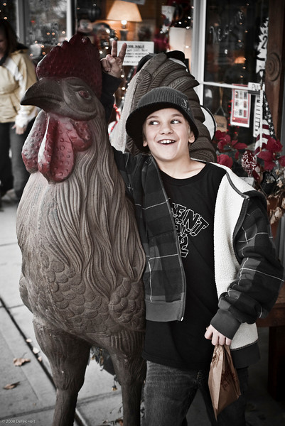 Micah and the giant iron rooster, downtown Dayton.