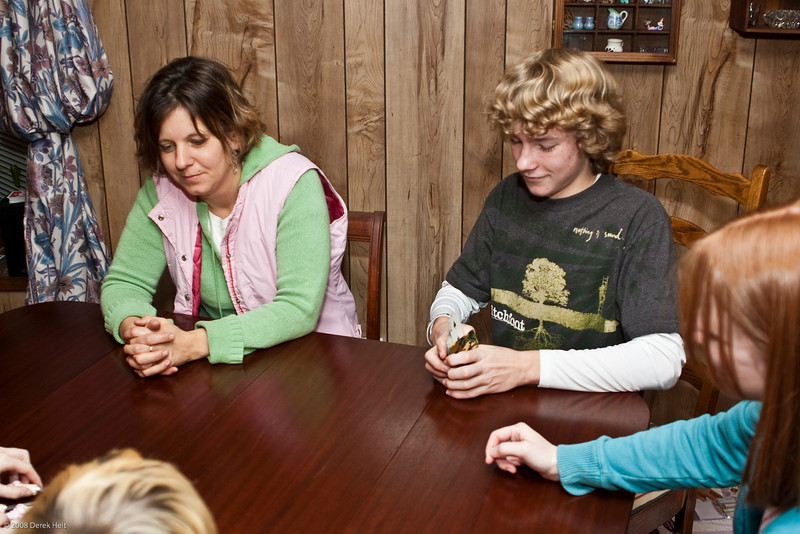 The competitive people in the family square off over cards & spoons.