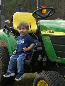Cole playing on tractor