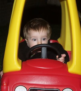 Sean driving a little car