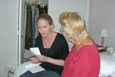 Ari showing Grandma the sonogram of the baby