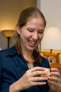 Abby demonstrating Origami balls.