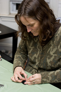 Michelle making an origami ball.