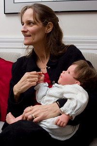 Michelle carefully gripping the baby's hand...
