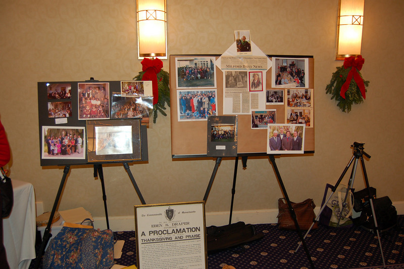Thanksgiving group photos of years past and other family photos on display an the banquet room.