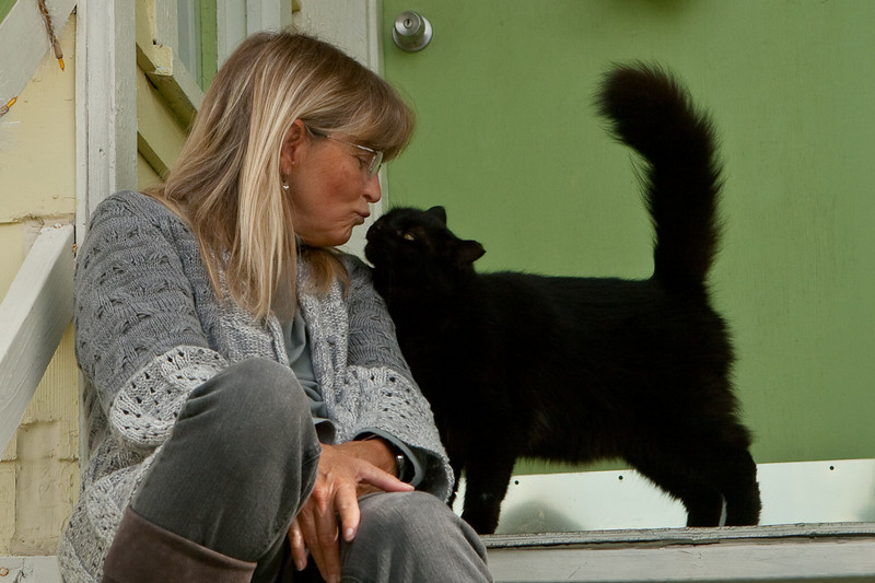 Becky & Sammy. Sammy is an Ike cat. She showed up homeless after Hurricane Ike. Some neighbors took her in. It was 3 weeks before she let anybody touch her. Becky started giving her treats and now Sammy spends alot of time hanging out at Becky's door.