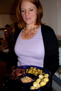 Dawn offering hors d'oeuvres. Feta-stuffed olives were particularly excellent.