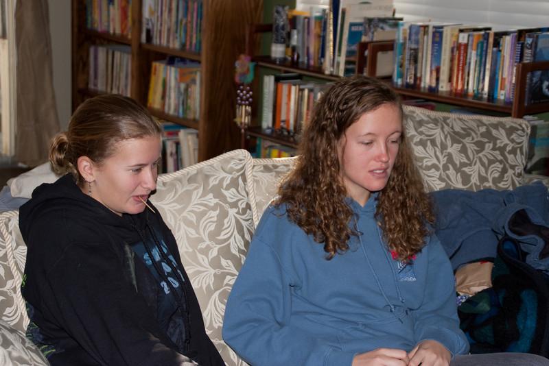 Katie and Elizabeth waiting for dinner. For a change, Elizabeth wasn't sitting on her sister.