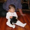 Charlotte with a stuffed monkey.