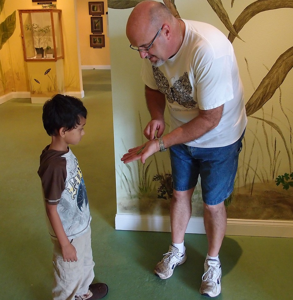 Butterfly Garden owner gets Peyton gets up close with a caterpillar