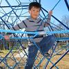 Jonathan playing on the climbing gym.