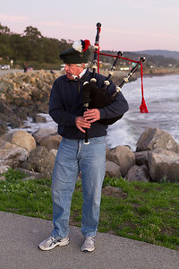 A lone piper helped to hurry the sun down.