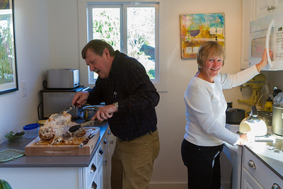 George carving the turkey, Donna checking the microwave