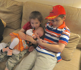 The boys liked to hold Stella.