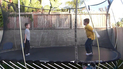 The trampoline and Meghan and Danny's house--Daniel & Joey