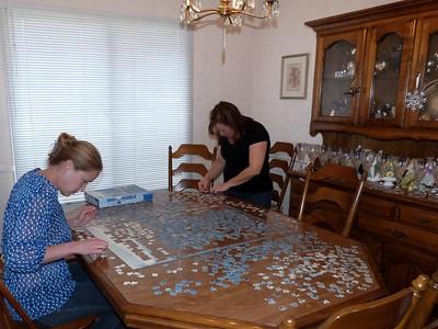 Ari & Emily work on the puzzle