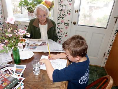 Great-Grandma is impressed as Joey practoces his writing