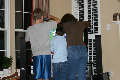 Michael, Timothy and Emily covering up the Cowboys game so Uncle Ken can't see it while they rewind