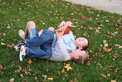 Timothy and Michael playing football in the front yard