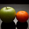 Don't compare apples and oranges (or at least tangerines).  Shot in our DIY Lightbox
