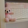 Pink teddy bear in the nursery