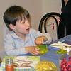 07-Karl opens his Hanukkah Gelt Dreidel