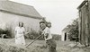 1941 Ellen and Allison raking hay between the garage and maple sugar house