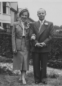 DPB-77: May (Maisie) Barr (nee McKeown) and David (Davy) Barr Snr at 187 Sandown Road, Belfast. The back reads:In the garden of 187. Good except for Davy's tie