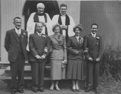 DPB-56: May (Maisie) Barr (nee McKeown) and David (Davy) Barr on wedding day 1952 with Edward (Eddie) Barr, Eileen Prentice (nee Montgomery) Rev. Mervyn and Canon Williams?