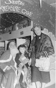 DPB-74: May (Maisie) Barr (nee McKeown) and David Barr Jnr visiting Santa's Grotto in local Belfast store