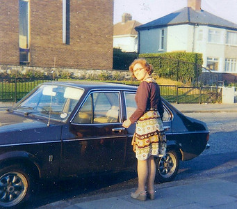 DPB-313: May (Maisie) Barr outside 666 Oldpark Road (Cissy Grogam's house), Belfast