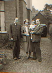 DPB-21: Robert (Bertie) Barr, May (Maisie) Barr (nee McKeown) and David Barr Snr holding David  at 187 Sandown Road, Belfast in 1954