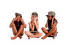 Inter-racial trio of young girls sitting on the floor playing hear no see no speak no evil